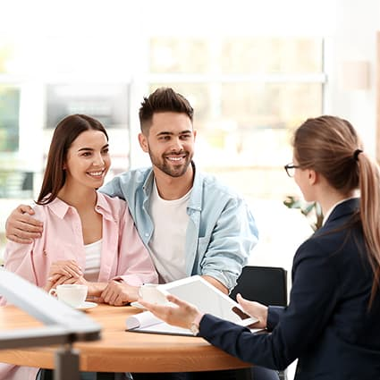 Young Couple Talking With Insurance Agent